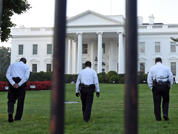 Uniformed Secret Service officers walk along the lawn on the North side of the White House in Washington Sept. 20, 2014.