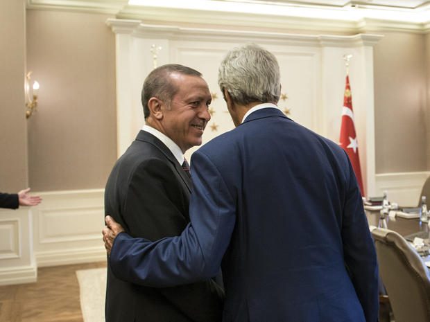 Turkish President Recep Tayyip Erdogan speaks with Secretary of State John Kerry