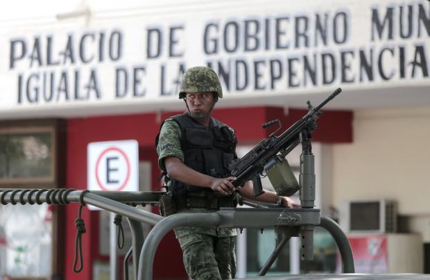 A Mexican soldier patrols in downtown Iguala, Guerrero state, Mexico