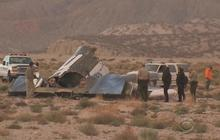 Federal investigators search for clues into Virgin Galactic crash