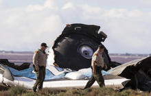 Search for clues after Virgin Galactic spaceship breaks during test