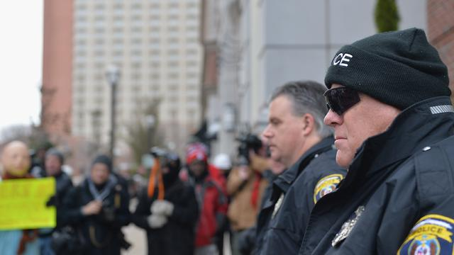 Clayton Police Department officers keep a watchful eye during a peaceful protest