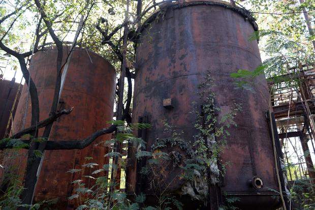 Abandoned equipment and broken storage tanks are seen at the now-defunct Union Carbide pesticide factory in Bhopal Nov. 28, 2014.