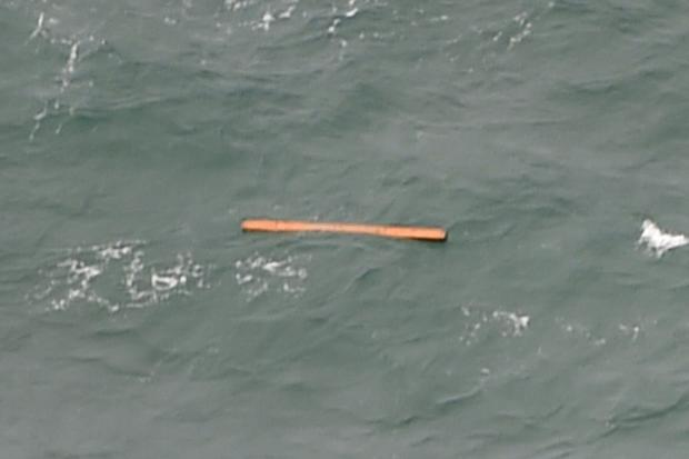 This aerial view taken from an Indonesian search and rescue aircraft over the Java Sea shows floating debris spotted in the same area as other items being investigated by Indonesian authorities as possible objects from missing AirAsia flight QZ8501
