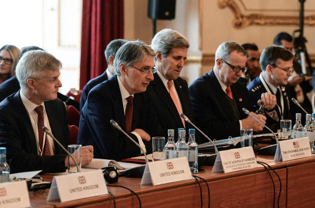 British Foreign Secretary Philip Hammond (2L) and US Secretary of State John Kerry (3L) co-host a meeting of members of an anti-Islamic State coalition (IS) at Lancaster House in London Jan. 22, 2015.