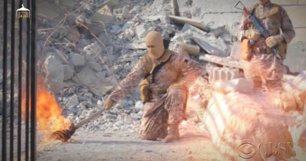 New ISIS video purportedly shows hostage being burned alive - CBS News