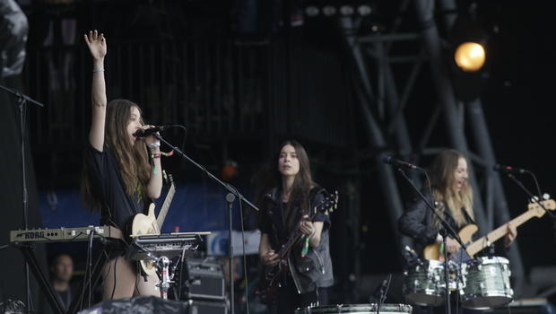 Alana, Danielle and Este Haim of Haim perform on the Pyramid Stage at the Glastonbury Music Festival at Glastonbury, England, June 28, 2013.