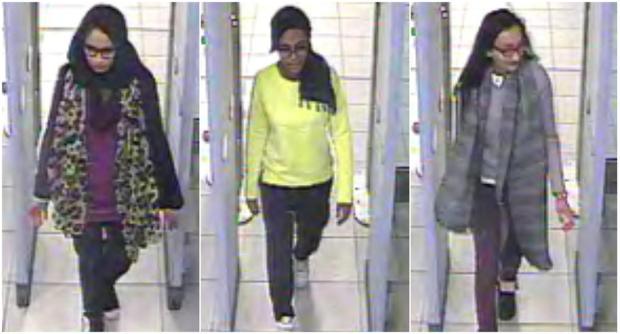 British teenage girls Shamima Begun, Amira Abase and Kadiza Sultana (L-R) walk through security at Gatwick Airport