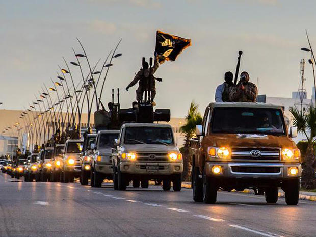 ​ISIS militants drive in procession through the northeastern Libyan city of Sirte