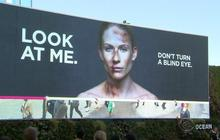 Domestic violence billboard dares people not to look away