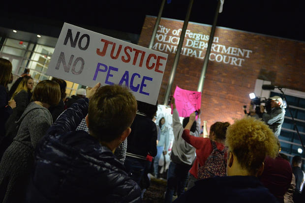 Demonstrators outside Ferguson, Missouri Police Department on March 11, 2015 after announcement that city's embattled police chief was resigning