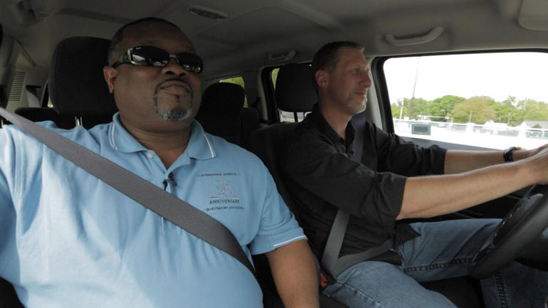 Agents Marlon Buggs, left, and Wayne Simock hit the road