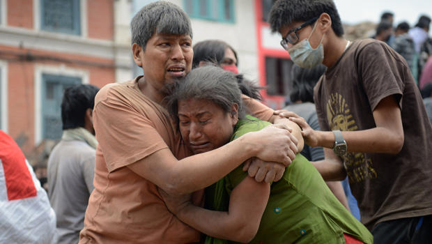 A Nepalese man and woman hold each other in Kathmandu's Durbar Square, a UNESCO World Heritage Site that was severely damaged by an earthquake, April 25, 2015.