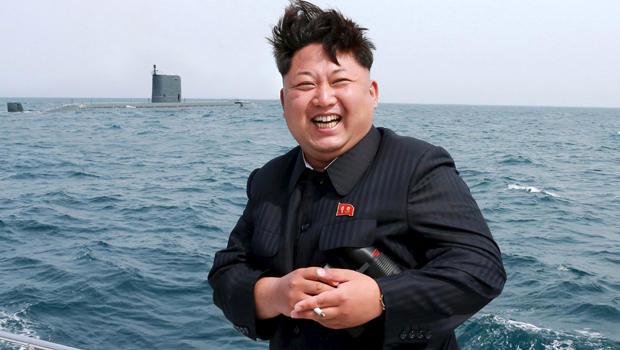 North Korean leader Kim Jong Un watches what the country's Korean Central News Agency (KCNA) says is a test-fire of a strategic submarine underwater ballistic missile in this undated photo released by KCNA in Pyongyang May 9, 2015.