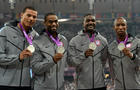 Ryan Bailey, Tyson Gay, Justin Gatlin and Trell Kimmons pose on the podium after winning the men's 4X100 relay final at the athletics event during the London 2012 Olympic Games Aug. 11, 2012, in London.