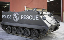 Obama curtails military gear to local police departments