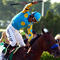 Victor Espinoza celebrates atop American Pharoah, No. 5, after winning the 147th running of the Belmont Stakes at Belmont Park June 6, 2015, in Elmont, New York.