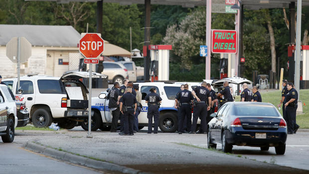 Police block the intersection of Dowdy Ferry Road and Interstate 45 during a standoff with a gunman barricaded inside a van June 13, 2015, in Hutchins, Texas. The gunman allegedly attacked Dallas Police headquarters.
