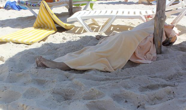 The body of an unidentified tourist shot dead by a gunman lies near a beachside hotel in Sousse