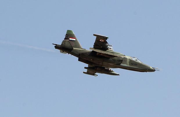 An Iraqi Sukhoi Su-25 jet flies over the town of Amerli