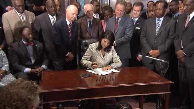 South Carolina Gov. Nikki Haley signs bill requiring removal of Confederate flag from state capitol grounds, on July 9, 2015
