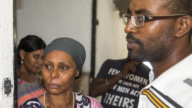 The brother and mother of Avraham Mengistu, 29, an Israeli of Ethiopian descent who is reportedly being held captive in the Gaza Strip, stand during a press conference in the southern city of Ashkelon