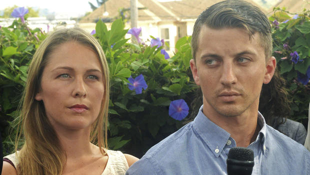 Denise Huskins and her boyfriend, Aaron Quinn, listen as their attorneys speak at a news conference July 13, 2015, in Vallejo, Calif.