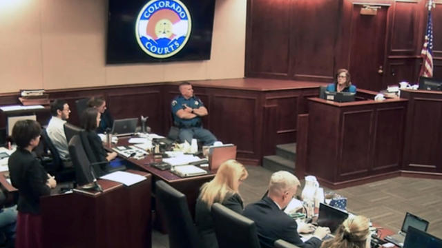 Arlene Holmes, top right, the mother of James Holmes, second from left, in white shirt, gives testimony during the sentencing phase of the Colorado theater shooting trial in Centennial, Colo., July 29, 2015, in this image made from Colorado Judicial Depar