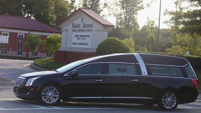 The hearse containing the casket of Bobbi Kristina Brown arrives at the St. James United Methodist Church Aug. 1, 2015, in Alpharetta, Georgia.