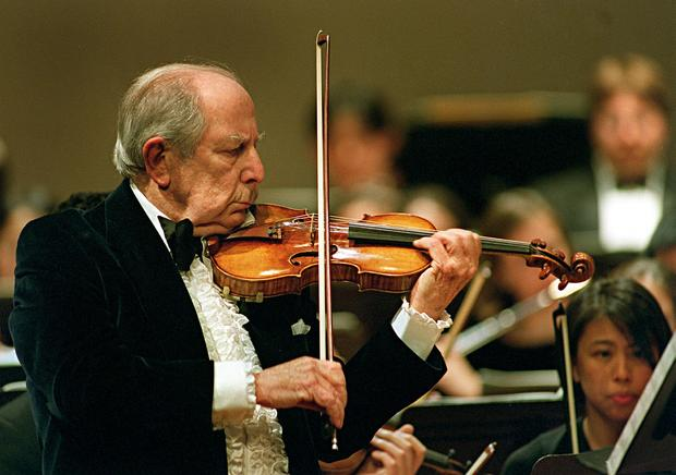 Roman Totenberg from Newton, Massachusetts, plays the violin solo for his 90th birthday concert celebration on stage at Boston University's Tsai Performance Center Feb. 5, 2001.