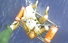 Watch: Coast Guard rescues three men, dog from sinking boat