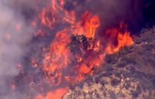 High heat and wildfires scorch west