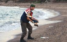 The story behind the front page death of a Syrian boy