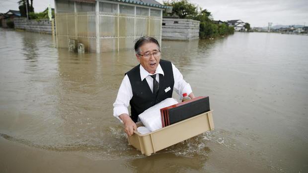 Floodwaters ravage Japan