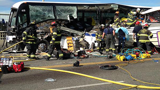 Firefighters assist victims after a crash between a bus and a tour vehicle on the Aurora Avenue bridge in Seattle, Washington, in this picture from the Seattle Fire Department Sept. 24, 2015.