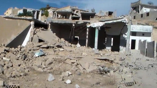 This image capture from online video posted by Syrian opposition activists purports to show damage from Russian airstrikes in Latamneh, in the northern Syrian governate of Hama, Sept. 30, 2015.