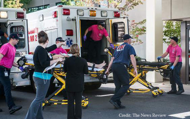 A patient is wheeled into the emergency room at Mercy Medical Center following a shooting at Umpqua Community College in Roseburg, Oregon, Oct. 1, 2015.