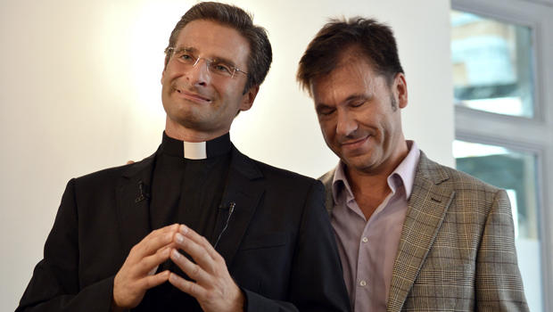 Krzysztof Charamsa, who works for a Vatican office, gives a press conference with his partner Eduard to reveal his homosexuality Oct. 3, 2015, in Rome.