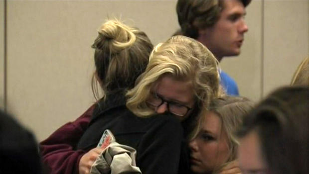 Two women embrace before Northern Arizona University officials hold a press conference on a deadly shooting on the campus in Flagstaff, Arizona, Oct. 9, 2015.