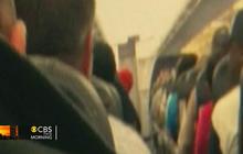 Plane engine explodes, smoke forces plane to turn back