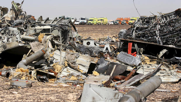 The remains of a Russian airliner are seen as rescue crews wait at the crash site in al-Hasanah in El Arish, Egypt, Nov. 1, 2015.
