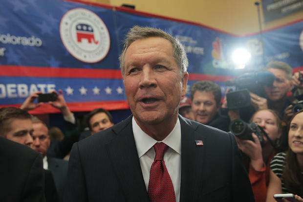Presidential candidate Ohio Gov. John Kasich speaks to the media in the spin room after the CNBC Republican Presidential Debate at the University of Colorado's Coors Events Center Oct. 28, 2015, in Boulder, Colorado.