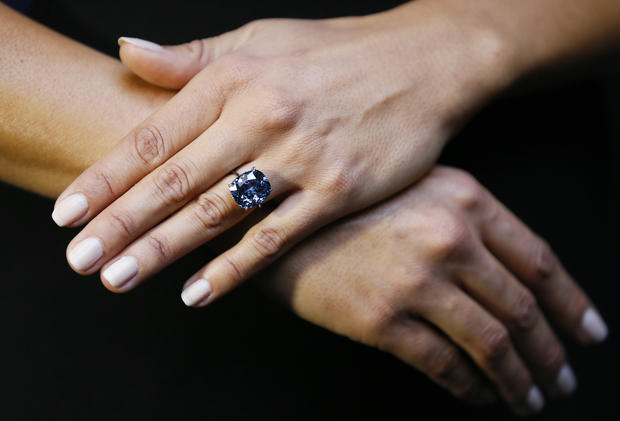 """The rare """"Blue Moon"""" Diamond is displayed at Sotheby's auction rooms in London Sept. 17, 2015."""