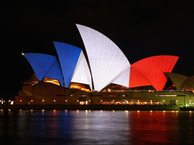 The sails of the Sydney Opera House are illuminated in the colors of the French flag on Nov. 14, 2015, in Sydney, Australia, in solidarity with the people of France.