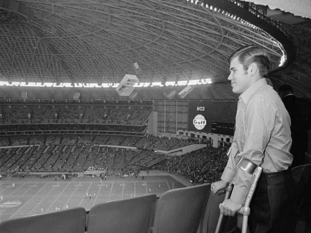 Freddie Steinmark, University of Texas defensive back, views pre-game activities at the Bluebonnet Bowl game between the University of Houston and Auburn University Dec. 31, 1969. Steinmark had his left leg removed after the discovery of cancer.
