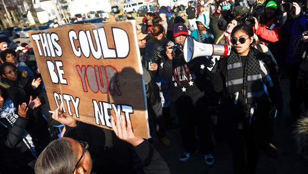 Mica Grimm, right, of Minneapolis, speaks to a gathering crowd of the group Black Lives Matter before they march to City Hall during a protest in Minneapolis, Minnesota, Nov. 24, 2015.