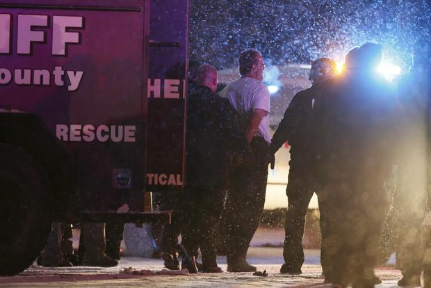 A suspect, identified as Robert Lewis Dear of North Carolina, is taken into custody outside a Planned Parenthood center in Colorado Springs, Colorado, Nov. 27, 2015.