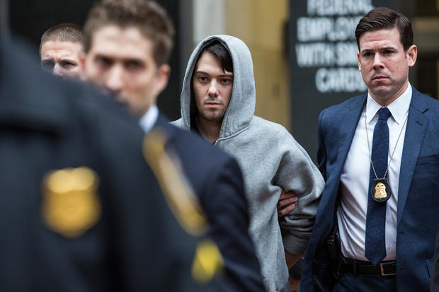 Martin Shkreli, center, CEO of Turing Pharmaceuticals, is brought out of 26 Federal Plaza by law enforcement officials after being arrested for securities fraud Dec. 17, 2015, in New York City.