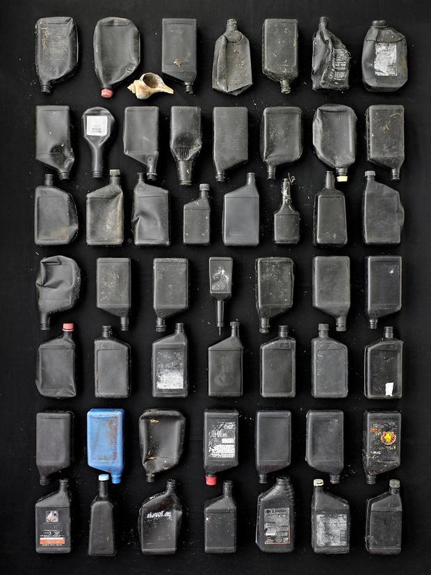barry-rosenthal-black-motor-oil-bottles-2.jpg