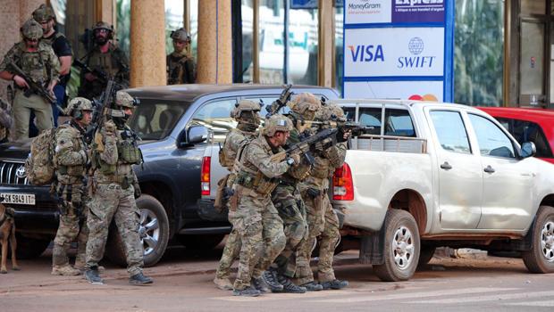 French special forces take position near the Splendid Hotel following an attack by al Qaeda-linked gunmen in Ouagadougou, Burkina Faso, Jan. 16, 2016.